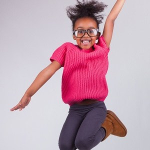 16116344 - portrait of cute young african american girl jumping, over gray background