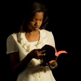 20991823 - an african american girl reads her bible.